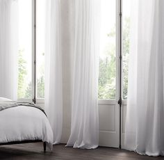 Windows Discover Belgian Sheer Linen Drapery RHs Belgian Sheer Linen Drapery:Loomed from the worlds finest Belgian flax the soft lightweight weave welcomes light. The sheer fabric dresses the window alone or pairs with heavier-weight panels. Muslin Curtains, White Linen Curtains, Drapes Curtains, Drapery, Bedroom Curtains, Curtains Direct, Patterned Curtains, Bedroom Decor, Short Curtains