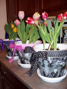 Flower pots with the kids' pictures -- I bet mom's and grandma's would love these..... Mothers day!!!
