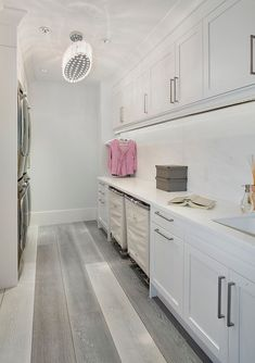 Laundry baskets on wheels helps save space in the laundry room