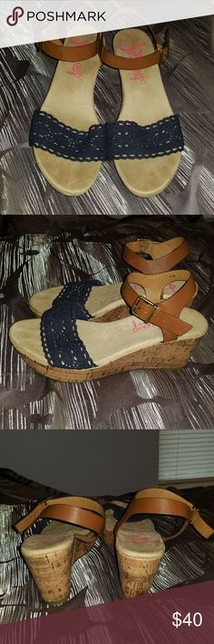 """Jelly Pop Memory Foam Sandals Shortcake Navy/Brown wedge sandal. Navy blue crochet. Brown synthetic leather. Cushioned shoe. Synthetic cork platform. 3"""" heel. 1-1/4"""" platform. Worn few times, Excellent condition. Shoes Wedges"""