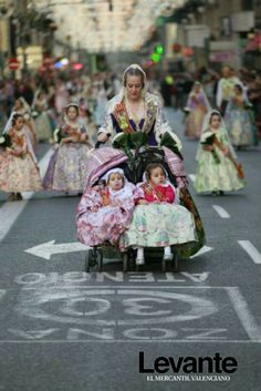 Offering flowers to the Virgin during Las Fallas of Valencia. Spain.