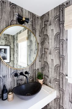 black and white graphic wallpaper powder room