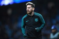 Lionel Messi of Barcelona warms up prior to kick off during the UEFA Champions League Group C match between Manchester City FC and FC Barcelona at Etihad Stadium on November 1, 2016 in Manchester, England.