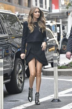 How Gigi Hadid Styles the Boots She Designed via @WhoWhatWear #allblack #blackoutfit #ankleboots