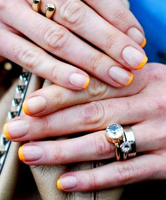 Electric Orange Tips Give a traditional French manicure a fun and summery twist by using a neon polish for your tips. Simply paint your nails any sheer nude shade, and once that is completely dry paint your tips in a bright orange, like Zoya in Paz, $8. For extra precision while drawing on the tips, use a thin paintbrush (you can buy one at any craft store). Finish with a clear topcoat.