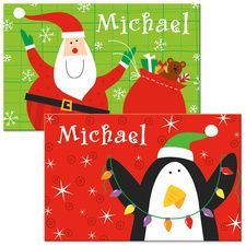 """Santa/Penguin Christmas Place Mat. Personalized on both sides with child's name, cute laminated place mats feature different holiday scenes on each side!11"""" x 17"""". Specify name, up to 10 characters and spaces. Price: $8.00"""