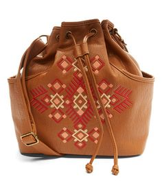This Cognac Embroidered Drawstring Bucket Bag is perfect! #zulilyfinds