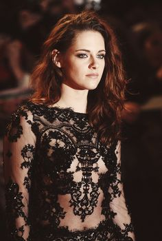Notice the dress and not that, once again, Kristen Stewart forgot to do her hair.