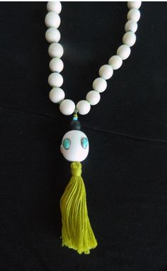 Jolie Kolaj showing off her NEW Melvin Wood Bead Necklace from SavVy in Greenville SC!