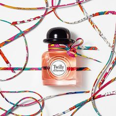Twilly d'Hermès the fashion house's latest fragrance in a bottle decorated with ribbon much like Hermès's patterned silk scarves. ปรบมดใหวนฝนพรำสดใสขนดวยนำหอมกลนใหมจากแอรเมส  via ELLE THAILAND MAGAZINE OFFICIAL INSTAGRAM - Fashion Campaigns  Haute Couture  Advertising  Editorial Photography  Magazine Cover Designs  Supermodels  Runway Models