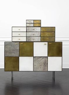 KELLY WEARSTLER   HUNTLEY CABINET. Blackened stainless steel body and solid walnut drawers and shelving