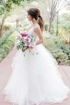 Blush by Hayley Paige gown in a Valentine's Inspired wedding photoshoot. Love the detail on the bodice and the bride's messy updo with the stunning gown.