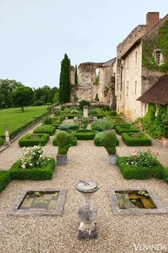 Plantings in the Medieval garden include roses, lavender, and topiary. GARDEN DESIGN BY LEVY-ALBAN - Veranda.com