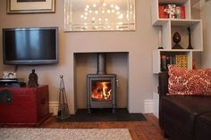 Rendered chamber with natural slate tiled hearth and a Contura wood stove fitted in Leigh on sea Essex 2012 Exposed Brick Fireplaces, Fireplace Surrounds, Fireplace Design, Fireplace Ideas, Wood Burner Fireplace, Wood Mantle, Log Burner Living Room, Slate Hearth, Hearth Tiles
