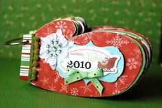 Holiday Wishes mini album - Scrapbook.com - Love this mitten mini album!