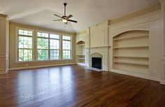 The Aberdeen Family Room with built in bookshelves and fireplace