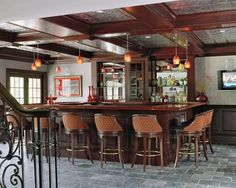 MDK Designs Associates, melanie@mdkdesigns.com. Custom built bar, coffered ceiling with aluminum inserts, Glass pendant lighting, slate floors with etched boarder. For more information contact melanie@mdkdesgins.com