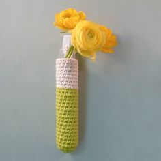 hanging bud vases - crochet - mix and match - includes glass test tubes. $30.00, via Etsy.