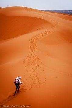 Marathon Des Sables. A six-day, 156 mile ultramarathon across the Sahara desert, carrying everything you need with you (food, water, clothing, sleeping gear, etc.).  Considered the toughest foot race on Earth.  Temperatures can reach 120F and up to 20% of the distance is across sand dunes.