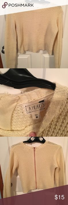 Cropped sweater Cream cropped sweater with zipper down back. Make me an offer, I'm willing to negotiate! LA Hearts Sweaters