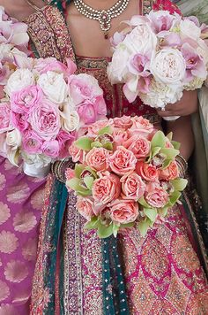 Nishi carried a bouquet of peach roses and green orchids, while her bridesmaids had flowers in shades of pink and white.