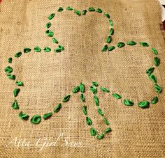 Atta Girl Says: Easy St. Patrick's Day Shamrock Pillow made from ribbon and burlap.