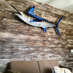 The Marlin is up on our new wood wall! My husband caught this last summer in Cabo and I made the distressed wood to show off his catch. Blue Marlin, Plank Walls, Repurposed Wood, Distressed Wood, Rustic Industrial, How To Distress Wood, Hgtv, Wood Pallets, Cabo