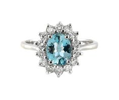 An 18ct White Gold, Blue Topaz and Diamond Halo Ring
