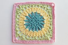 """Pattern: Square 99 from Leisure Arts 99 Granny Squares to Crochet Hook used: J Finished size: 10"""" Colors Used: Michael's Loops and Threads Impeccable Worsted Aqua and Soft Fern Hobby Lobby's I love this yarn Buttercup and metallic Pinky Toes Another big sunflower square. I think this one might be..."""