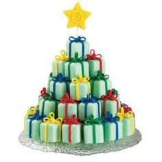 Build a dramatic Christmas tree cake by layering 48 small cakes. Using a firm-textured batter such as pound cake will allow this tower of treats to hold its shape.