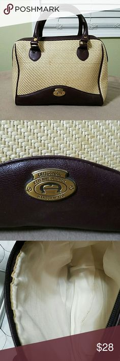 Etienne Aigner handbag Etienne Aigner handbag.  In great used condition.  Length side to side is 10 inches.  Width on the side of the purse is4 inches.  Depth from top to bottom is 9 inches. Etienne Aigner Bags