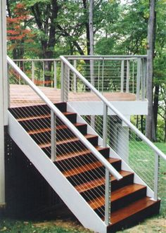 Deck railing style by CableRail - like the dark wood contrast with the silver metal rail