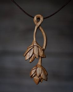 giles newman, hand carved, lotus pendant in wood