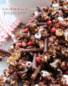 Rudolph Popcorn a cinnamon chocolate kettle corn, mixed with red hot candies as Rudolph's nose and pretzel sticks as his antlers.
