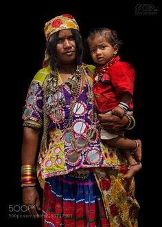 Popular on 500px : Banjara woman with child by scipbe
