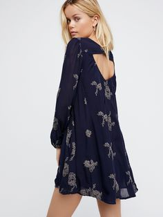 Embroidered Austin Dress | Flowy swing dress with beautiful floral embroidered design. Elastic band at bust and cuffs. Deep