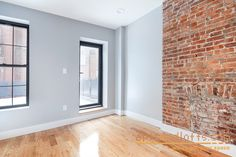 Gray walls with exposed brick chimney at Park Slope rental building at 806 President Street.
