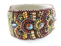 Bead embroidered bracelet with cabochon and beads in shades of fall colors ...