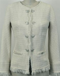 Chanel, done in a mostly-wool tweed interspersed with tiny glass pearls. Note the bust seaming to allow for figure-flattery (it won't hang like a box) and typical self-fringe treatment.