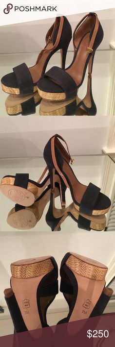 Tory Burch Navy stiletto size 7 Worn once 5 1/2 inch with two inch platform! Buckles around ankle with brown leather strap Tory Burch Shoes Heels