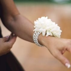 Floral Wrist Corsages.. the beaded band around the wrist is so much prettier than the regular elastic bands