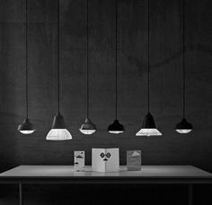 kimu design studio's 'new old light' combines simple wooden shades with paper lanterns.
