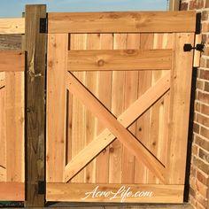 Cedar gate with rustic X design.