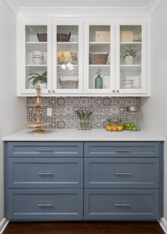 Custom Buffet serving cabinet. Glass shaker upper cabinets. Sherwin Williams Granite Peak paint on lower cabinets.  See full article on this kitchen at link below.