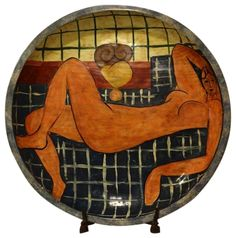 Decorative plate with reclining female figure. This very large plate fuses suggestions of several eras of art: a Picasso-esque painting of a Renaissance-style reclining female figure with colors of ancient Greek pottery.