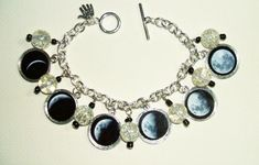 MOON PHASES Charm Bracelet Celestial Lunar Altered ART on Luulla. I would love to have this bracelet. I love the moon!