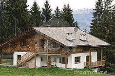 Traditional wooden house in the mountains in Italy