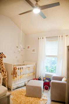 Dormitorio para bebés con jirafas