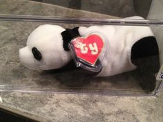 Conquering the world back in the 1990s, the Beanie Babies didn't have to try hard to captivate the hearts no... -  Peking the Panda Beanie Baby3 . Discover More at: http://www.topteny.com/top-10-rarest-beanie-babies-world/