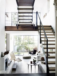 AMAZING modern living room - those stairs!!